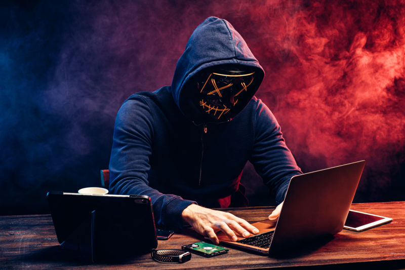 hacker man typing on laptop, hacking computer system