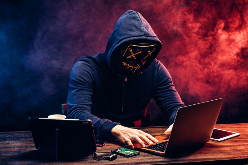 hacker man typing on laptop, hacking computer system